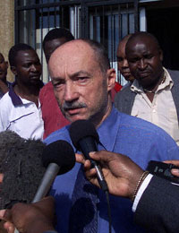 Iden Wetherell, the award-winning editor of the Zimbabwe Independent, speaks to reporters after he was released on bail, Jan. 12, 2004