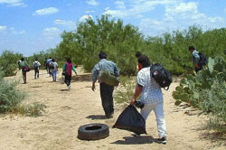 Mexican men and women cross the border into Texas illegally
