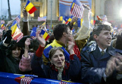 Crowds in Bucharest cheer U.S. President George W. Bush