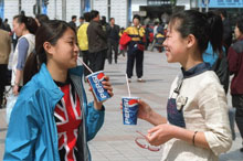 Chinese girls drink Pepsi in Beijing