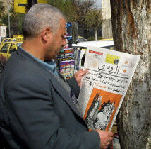 A Syrian man reads the first Syrian satirical weekly to be published in 38 years.