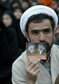 A man at an election rally in Kerman, Iran, holds a brochure for two conservative candidates standing in the Feb. 20 legislative elections