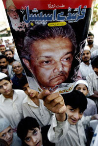 Young Pakistani demonstrators hold up a magazine cover featuring Pakistani nuclear scientist Abdul Qadeer Khan.