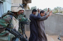 U.S. soldiers search Iraqi civilians