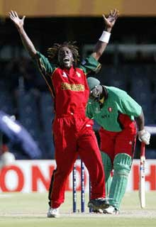 Zimbabwean bowler Henry Olanga wore a black arm band to protest the death of democracy in Zimbabwe