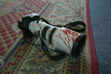 A bloodied camera at the Hotel Palestine in Baghdad. The hotel, which houses a number of foreign journalists, was hit by a U.S. airstrike on April 8, 2003.