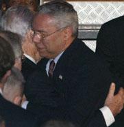 Powell hugs Peres