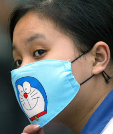A Beijing girl wears a fashionable SARS mask.