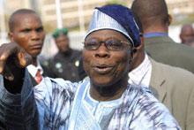Nigerian President Obasanjo is pleased