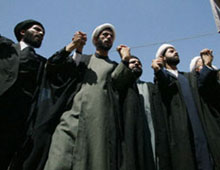 Iraqi Shiite clerics lead a demonstration against U.S. government of Iraq