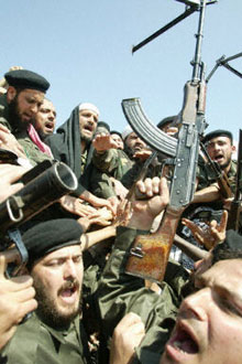 Arab volunteers outside Baghdad prepare for the American advance