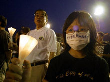 A candlelight vigil for victims of SARS in China