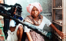 An elderly Acehnese woman after having narrowly escaped a battle in Aceh