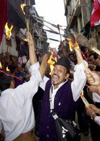 Kathmandu residents protest the king's treatment of parliament, June 30, 2003