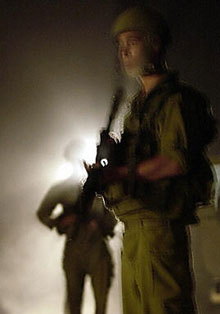 Israeli soldiers prepare to leave the Gaza Strip