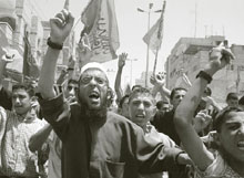 Hamas supporters in the Rafah refugee camp in Gaza demonstrate on June 6, 2003