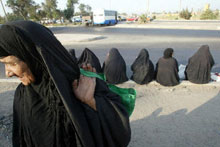 Iraqi women wait for work