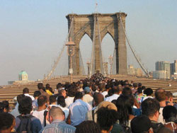 New Yorkers cross the Brooklyn Bridge during the Aug. 14 blackout