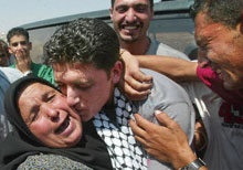 A Palestinian prisoner released on Aug. 6 returns to a tearful welcome from his family.