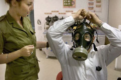 Israeli man tries on new gas mask