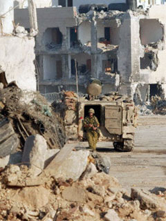 Israeli soldiers in the remains of Arafat's HQ