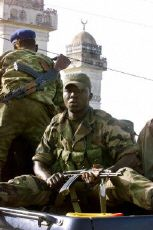 Rebel soldiers patrol the streets of Sakassou, Cote d'Ivoire