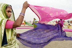 A woman dries her sari in the wind near Kolkata