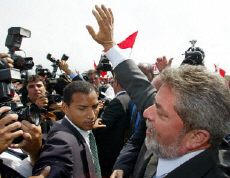 Lula waves to supporters after winning Brazil's presidential elections