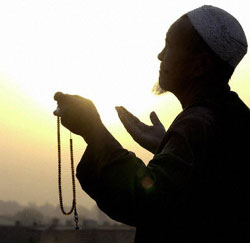 A Kabul man prays at sunset