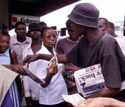 Zimbabweans scramble to buy the Daily News after it briefly appeared on newsstands again, Oct. 25, 2003
