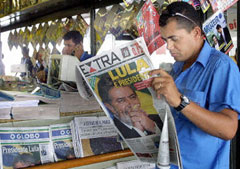 Man reads paper in Brazil