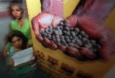 Indonesians Vendi Arelia (top) and Supriyati help launch an Oxfam campaign to expose the unequal status of Third World coffee growers and multi-national food companies