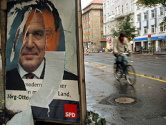 Ripped poster from the German election campaign