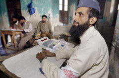 Kashmir election worker in an empty polling station
