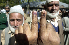 On Oct. 8, the fourth and final day of the Kashmiri polls, two men in Darpora show the ink stains on their fingers indicatingthat they have voted