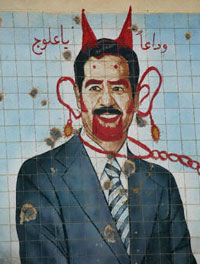 Defaced mural of Saddam Hussein