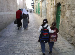 Palestinian girls and women walk the streets of East Jerusalem