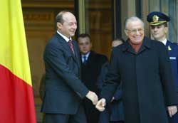 Romanian President Traian Basescu and outgoing President Ion Iliescu