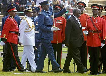 Kenya's President, Mwai Kibaki (right), inspects the honour guard