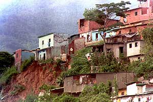 A Caracas slum with shacks clinging onto a mountain side