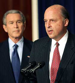 U.S. Ambassador to Iraq John Negroponte (right) speaks at a press conference with President Bush