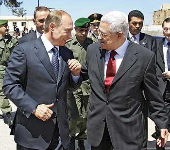 Russian President Vladimir V. Putin (left) talks to Palestinian President Mahmoud Abbas