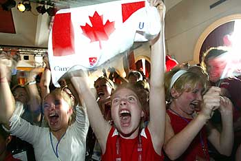 Canadian fans celebrate in Prague after the International Olympic Committee (IOC) vote that Vancouver won the 2010 Winter Olympics