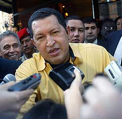 Venezuelan President Hugo Chavez talks to the press