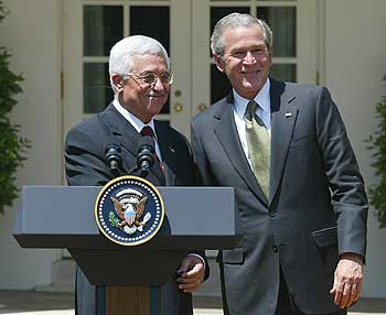 President Bush poses with Palestinian leader Mahmud Abbas