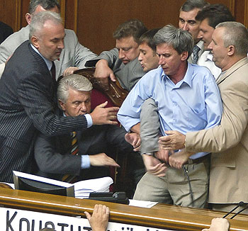 Ukrainian deputies fight with colleagues from the opposition July 6 during a debate in the Parliament