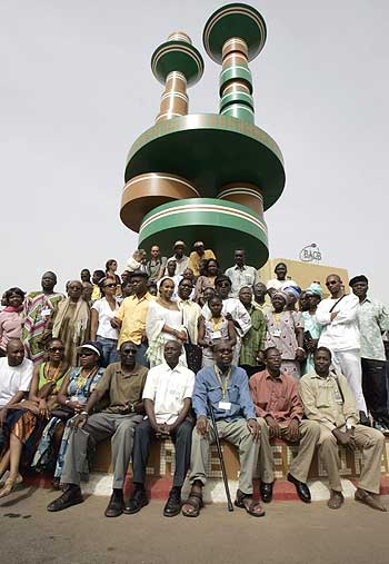 African moviemakers and actors pose in Ouagadougou, Burkina Faso, during a ceremony in February to honor African moviemakers