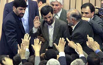 Mahmood Ahmadinejad, Iran's new president, waves to supporters