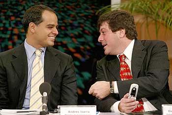 President of Telesur, Andres Izarra (left)