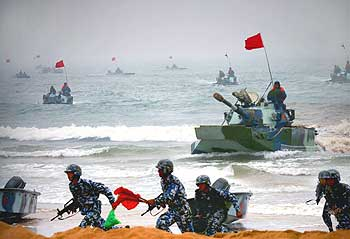 Chinese tanks and marines participate in an amphibious assault drill